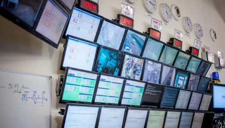 The numerous monitoring screens installed in the RBX1 control room.